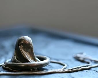 sterling silver condom necklace cast silver pendant