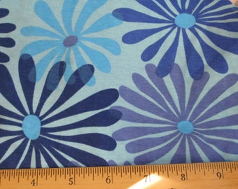Fanciful Daisies on Blue cotton lycra knit fabric