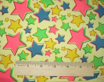 Amazing Neon Bright Stars on Yellow cotton Lycra Knit Fabric