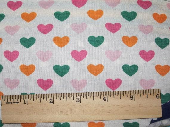 Pretty Candy hearts on Lycra Jersey Knit Fabric