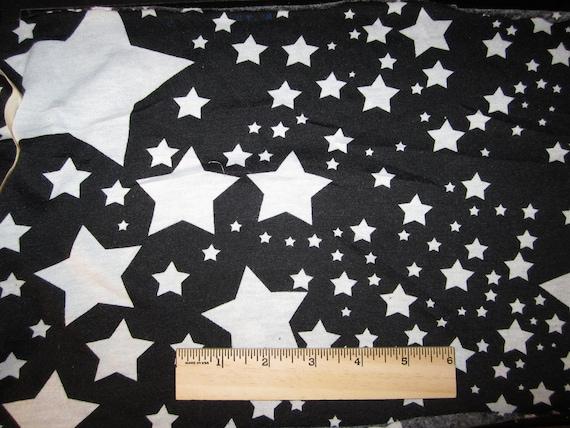White Stars on Black Knit Fabric