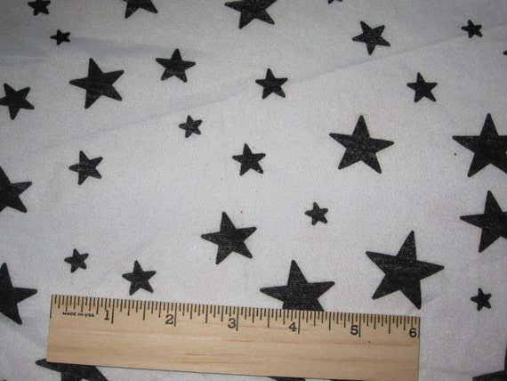 Black Stars on White Knit Fabric