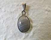 silver pendant with oval striped grey agate