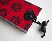 Red hungarian folk art motif string and button closure notepad