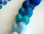 Seven blue felt hearts... I see skies of blue... what a wonderful word... turquoise, baby blue, cadet, peacock, royal blue, neon blue...