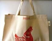 Organic canvas shopping bag - handprinted 'CHOOKIE' in orange