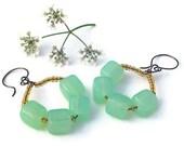 Green glass beaded earrings.  wire hoop earrings. amber orange and green dangle earrings