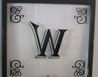 Custom Letter on a vintage wood window