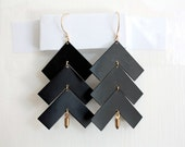 matte black chevron and gold-accented earrings