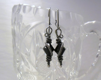 Earrings - Midnight Magic - Sterling Silver adorned with Jet Black Swarovski bi-cone bead.