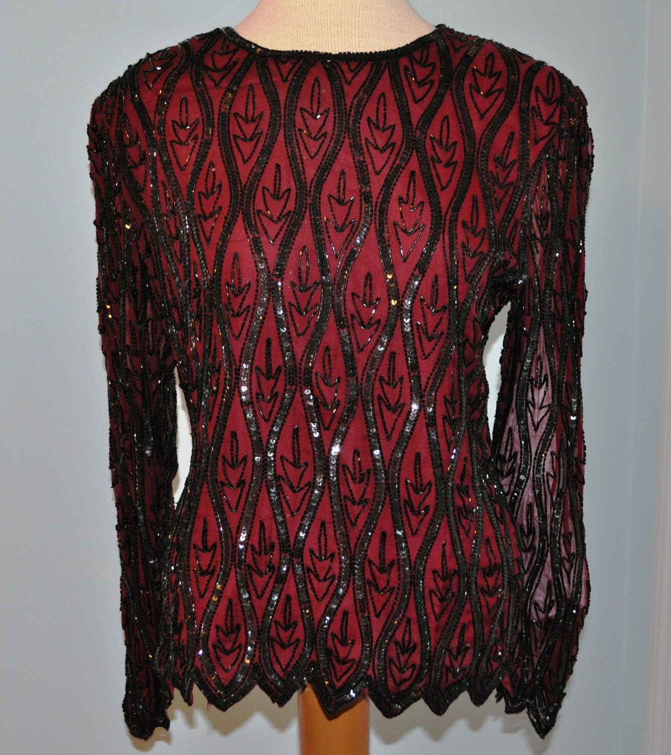Shiny s (circa) evening blouse. Comes in red with a revere front.