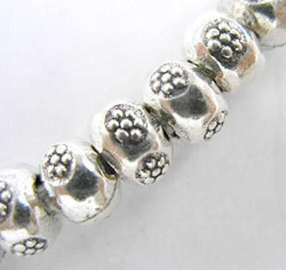 8 of Karen Hill Tribe Silver Daisy Imprint Beads 7x5 mm. :ka2066