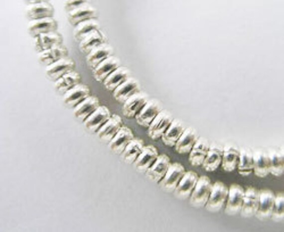 100 of Karen Hill Tribe Silver Little Ring Beads 2.7x1 mm. :ka2755