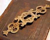RESERVED FOR vintageminx01 Vintage Elegant brass Oriental style key hole escutcheon.