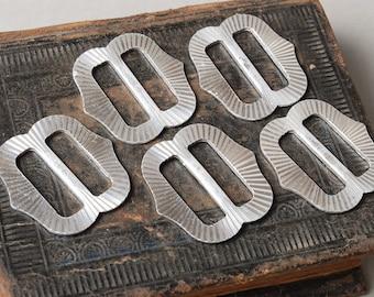 Set of 5 Vintage aluminium belt buckles.