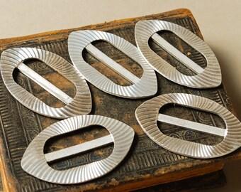 Set of 5 Vintage aluminum belt buckles.