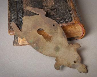 Vintage brass key hole escutcheon. Old dark patina