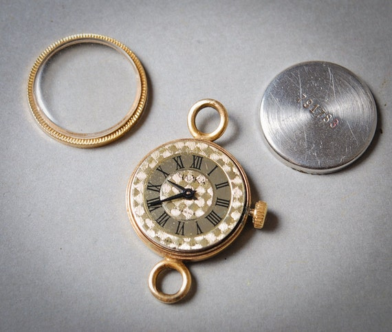 Vintage watch movement, watch parts, watch face, case.