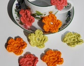 Crochet flowers in pink green and orange