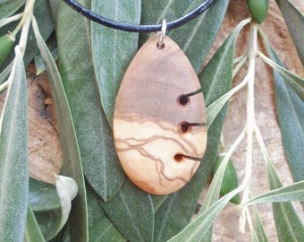 Olive Wood Maori style necklace, designed and carved by Eric Kempson