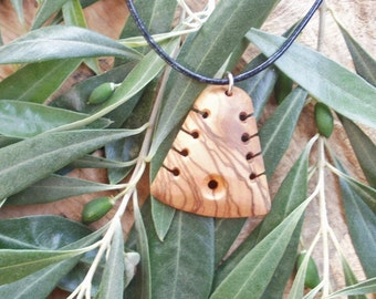 Olive Wood Maori style necklace, designed and carved by Eric Kempson for Ellenis Workshop