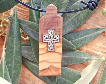 Olive Wood necklace inlaid with Tibetan silver cross, designed and carved by Eric Kempson