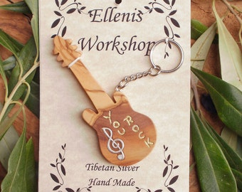 Hand carved Greek Olive Wood musical key chain guitar inlaid with Tibetan silver treble clef and engraved with you rock