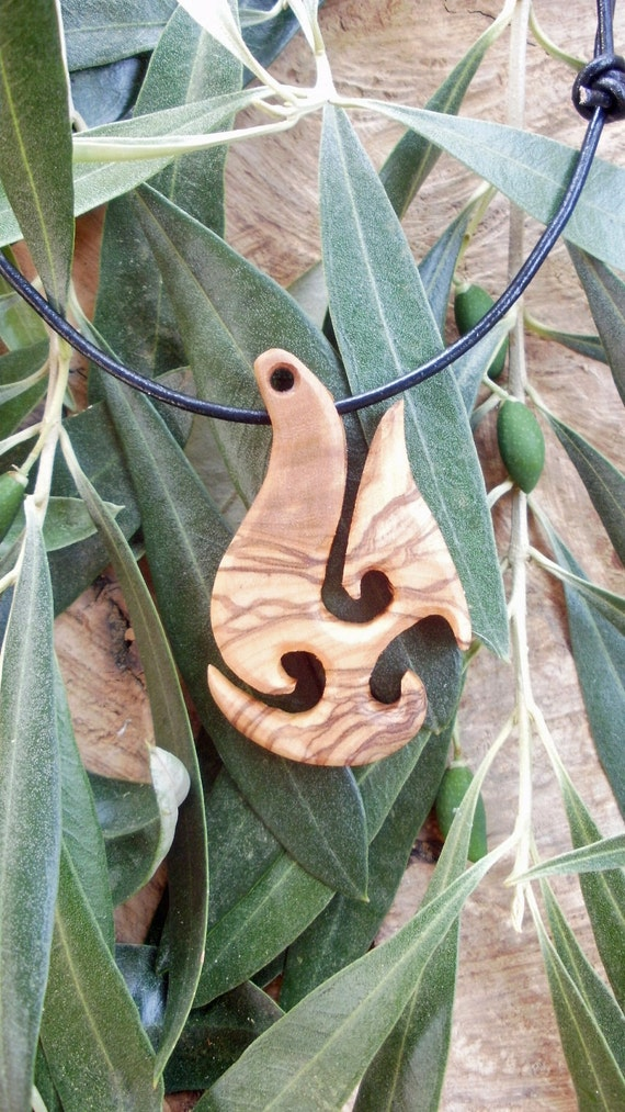 Olive Wood Maori style fish hook necklace a symbol of Prosperity and Abundance