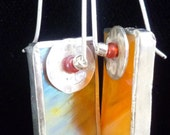 Irridized glass earrings orange reflecting blue and gold