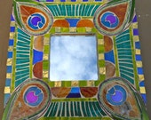 Peackock mirror in jewel tones