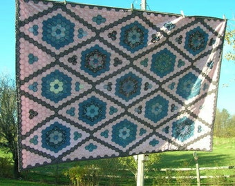 Grandmother's Flower Garden Quilt in Pinks and Blues.