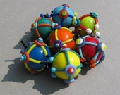 "Handmade lampwork  glass bead set ""Abstract"" in vibrant colors like blue, yellow, red, orange, green by Flamejewels"