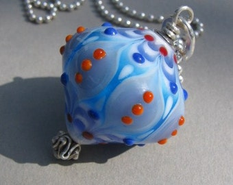 Handmade lampwork glass pendant in different shades of blue by Flamejewels