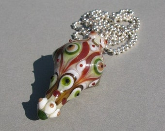 Handmade lampwork glass focal bead in different shades of green, brown and beige by Flamejewels.