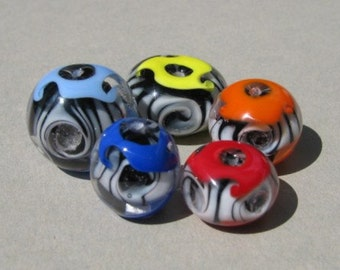 SALE: Handmade lampwork glass bead set in black and white with yellow, orange, red and blue by Flamejewels