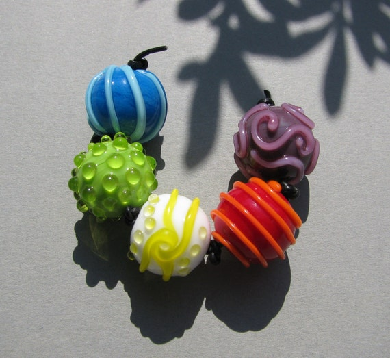 "Handmade lampwork glass bead set ""Bright"" in bright, vibrant colors like blue, green, red, purple by Flamejewels."