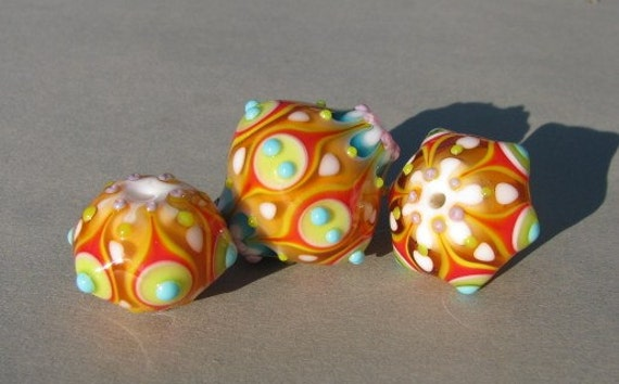 Handmade lampwork colorful glass bead set in orange, red, yellow white and blue by Flamejewels.