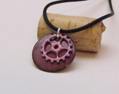 bike jewelry - ride like a girl - pink enameled copper bicycle gear pendant on black silicone cord