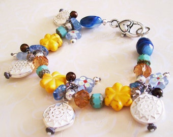 Bracelet  Cluster Charms  with Dark Blue, Golden Yellow, White, and Soft Teal Beads 7 inches with an extender chain