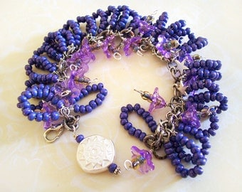 Bracelet Purple and Blue beaded Pretty Petals with silver charm 7.5 inches plus extender chain