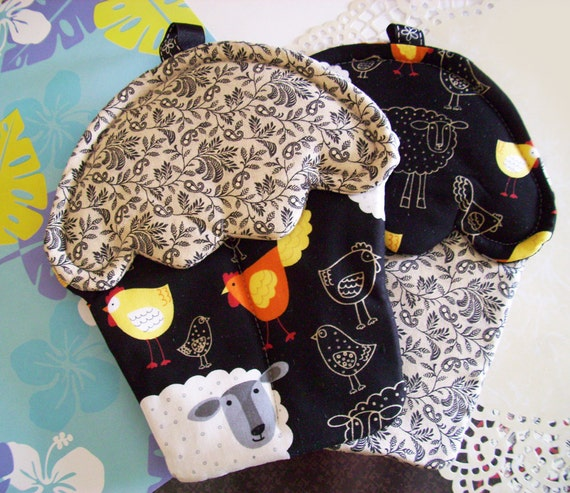 Handmade sheep and chicken themed Cupcake shaped oven mitts with black, orange, yellow, white material pot holders