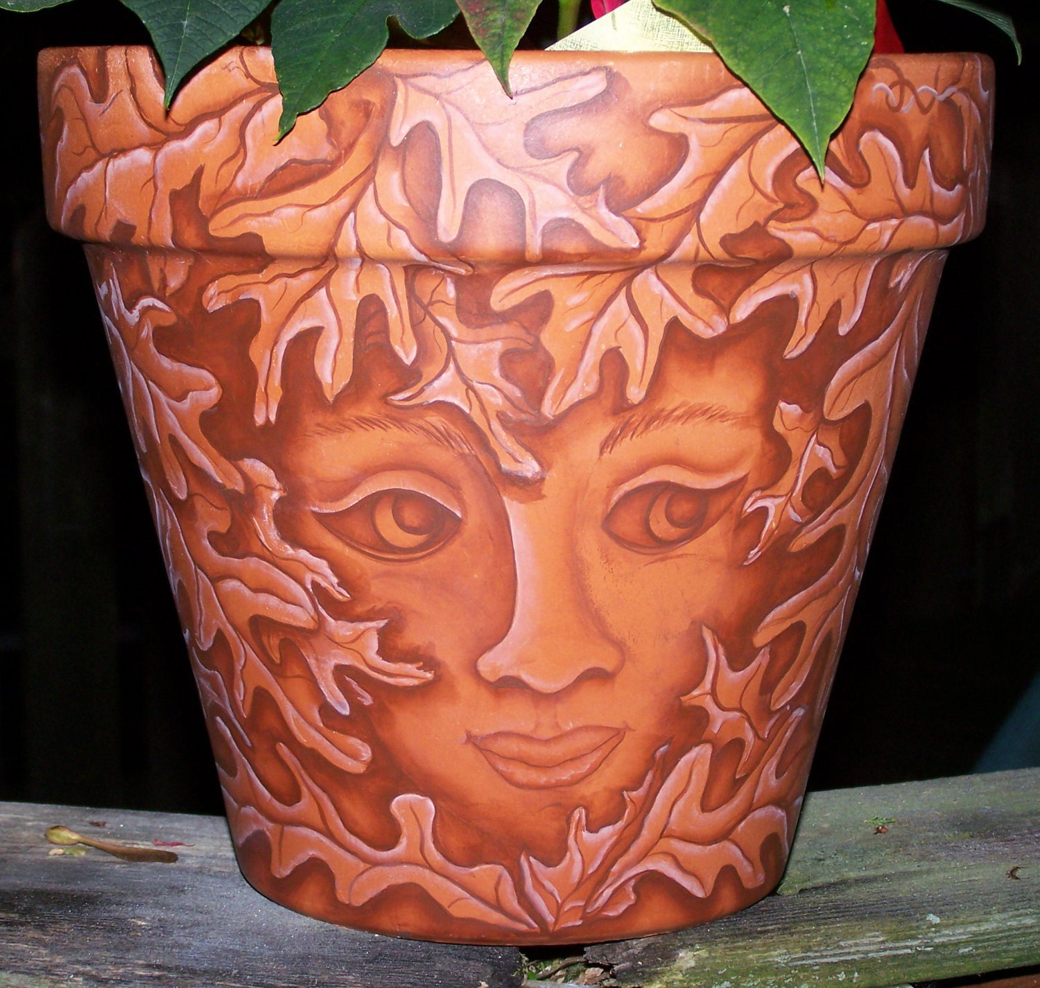 painted flower pot face in the leaves hand painted. Black Bedroom Furniture Sets. Home Design Ideas