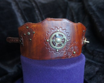 Steampunk cuff with brass cog detailing
