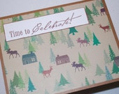 "Time To Celebrate""  green,brown card with deer, moose and cabins"