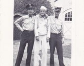 1940's photo .Police arrest goffy mental patient