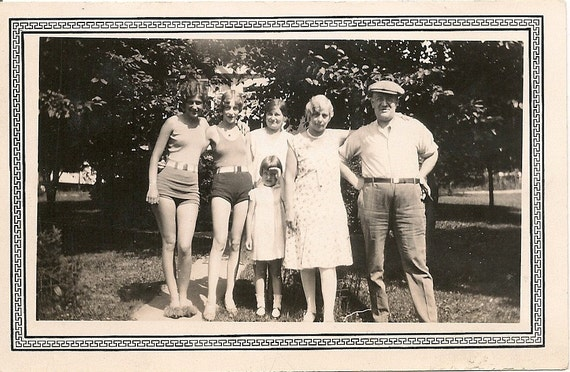 1930's Yopung women in bathing suits posing with family
