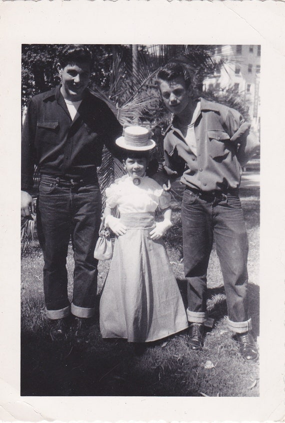 1950s greaser boys pose with little girl in by tobycreek