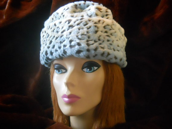 A fun faux fur hat that keeps you warm and feeling loved comes with Birth/Care Certiticate and set of eyes