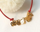 Baby Skull Bracelet -gold plated brass in red cord