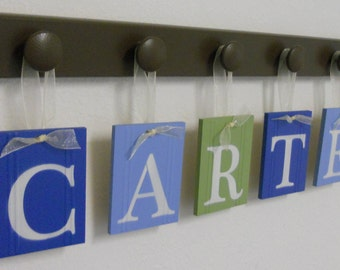 Personalized Babies Name Signs Includes Wooden Pegs Colors Chocolate Browns, Blues and Light Green. Simple Bedroom Decorating Ideas